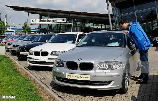 A customer looks at used Bayerische Motoren Werke 1 series cars at a BMW car dealership in Rosenheim Germany on Tuesday May 18 2010 Bayerische...