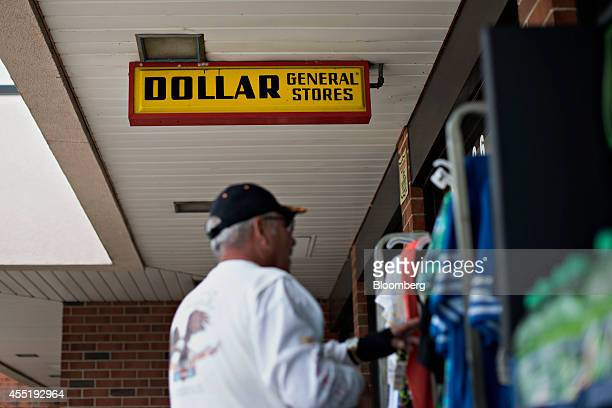A customer looks over a rack of shirts outside a Dollar General Corp store in Silvis Illinois US on Wednesday Sept 10 2014 Dollar General Corp...