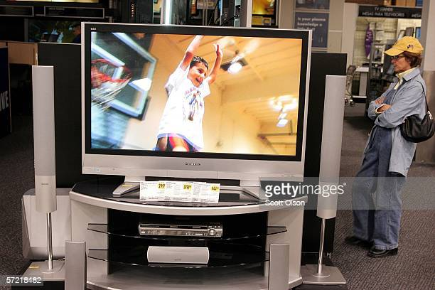 A customer looks over flatpanel televisions at a Best Buy store March 30 2006 in Chicago Illinois Best Buy Co Inc the nations largest consumer...