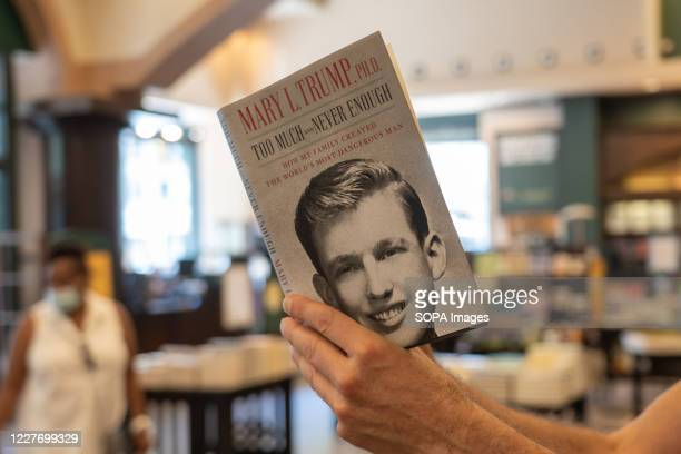 Customer looks through Mary L. Trump's new book about the U.S. President Donald J. Trump is on display at Barnes & Noble store on Broadway in...