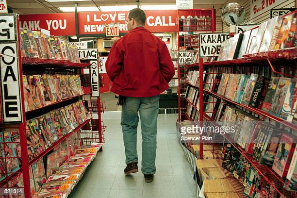 A customer looks to purchase a pornographic video April 3 2001 in New York's Times Square Frustrated by the presence of scores of thriving adult...