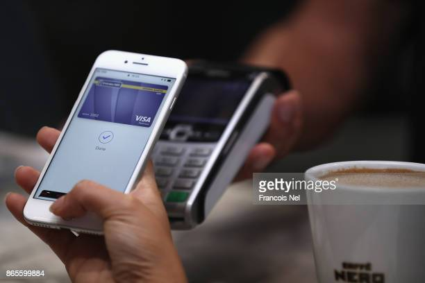 A customer makes a transaction using Apple Pay in the UAE at The Dubai Mall on October 22 2017 in Dubai United Arab Emirates
