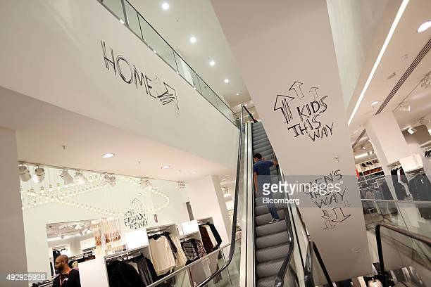 A customer makes their way up an escalator at a HM fashion clothing store operated by Hennes and Mauritz AB in London UK on Friday Oct 16 2015...