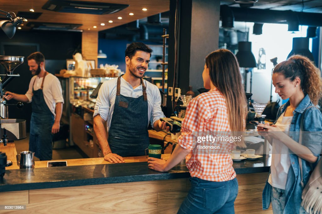 Customer making a contactless payment : Stock Photo