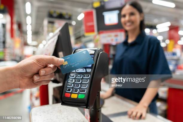 customer making a smart payment at the hardware store - credit card reader stock pictures, royalty-free photos & images