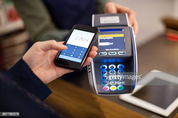 Customer making NFC payment by worker