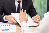 Customer or woman says no or hold on when businessman giving pen for signing a contract