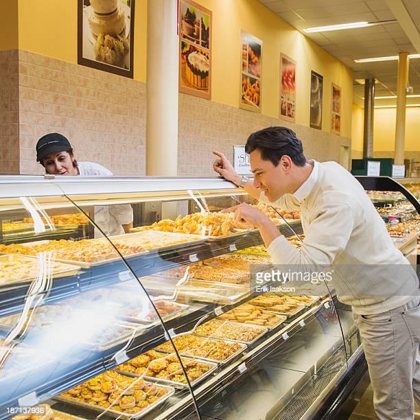 Customer ordering at restaurant counter