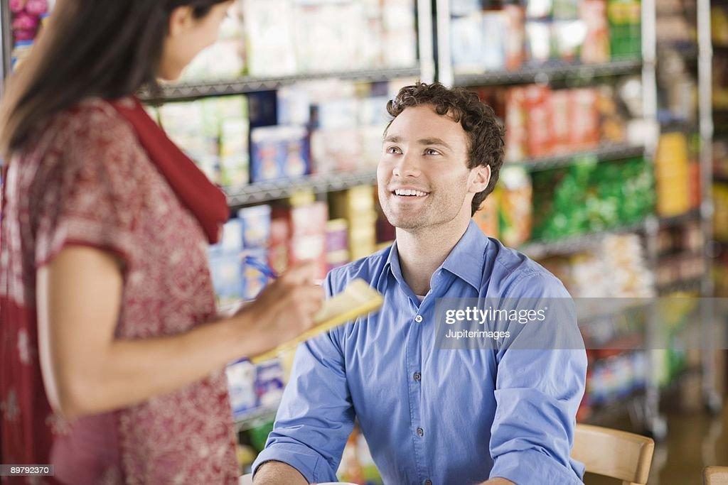 Customer ordering from waitress : Stock Photo