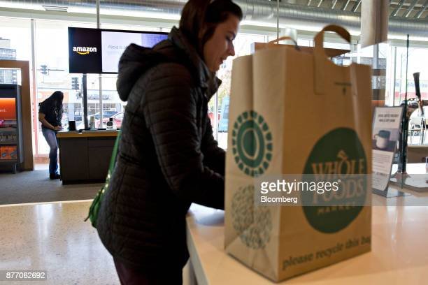 A customer orders a beverage in front of an Amazoncom Inc PopUp store inside the Lakeview Whole Foods Market Inc store in Chicago Illinois US on...