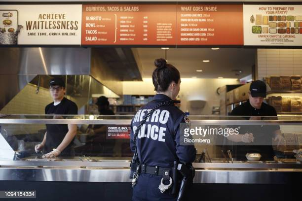 A customer orders food at a Chipotle Mexican Grill Inc restaurant in Louisville Kentucky US on Saturday Feb 2 2019 Chipotle Mexican Grill Inc is...