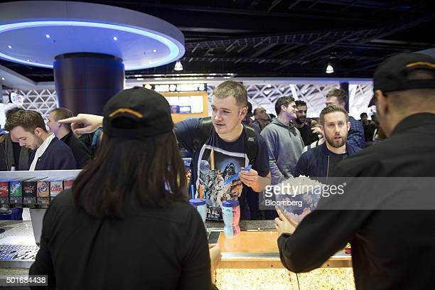 A customer orders food at the first public screening of Walt Disney Co's Star Wars The Force Awakens at a Vue Entertainment Ltd cinema in London UK...