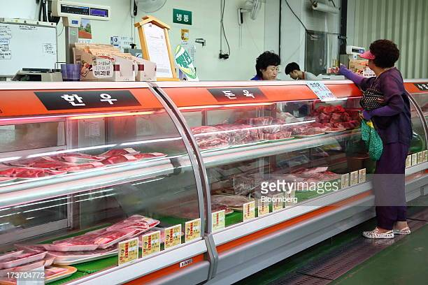 Customer orders meat at a butcher's shop at Noeun Agricultural and Marine Products Wholesale Market in Daejeon, South Korea, on Tuesday, July 16,...