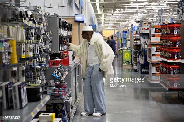 A customer over car stereo equipment while shopping at a Wal