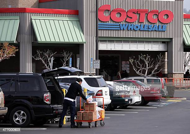 A customer packs groceries into his car outside of a Costco store on March 6 2014 in Richmond California Costco Wholesale reported a 15 percent drop...