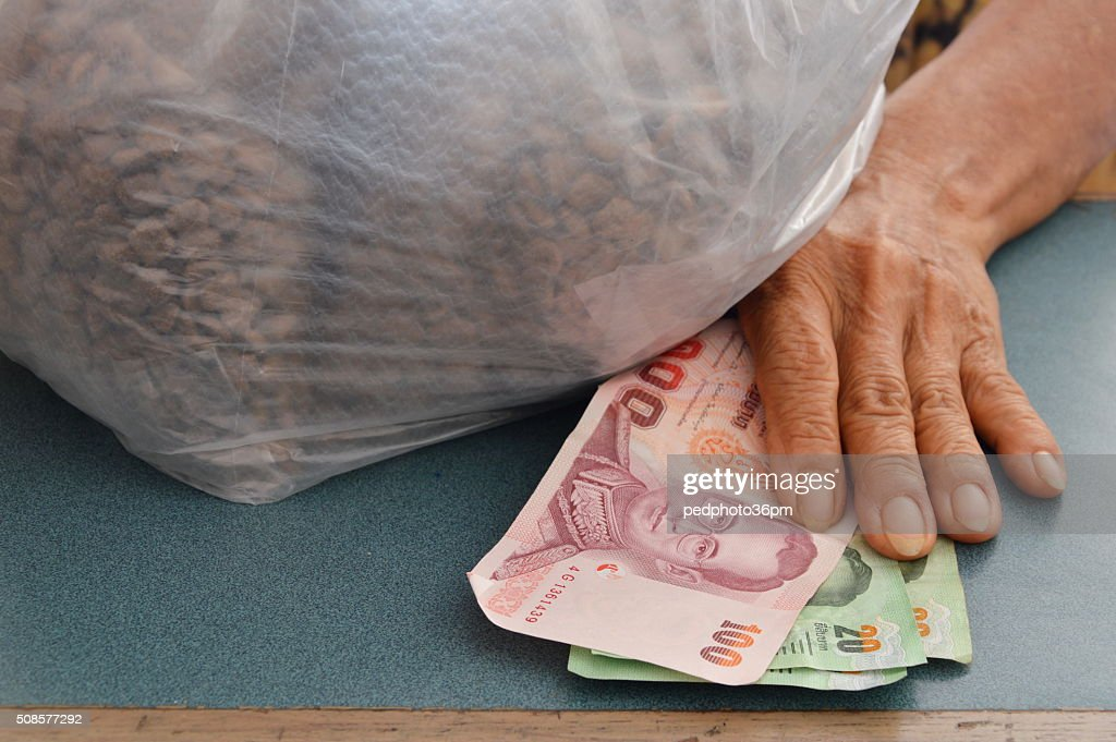customer paid for product in grocery shop : Stock Photo