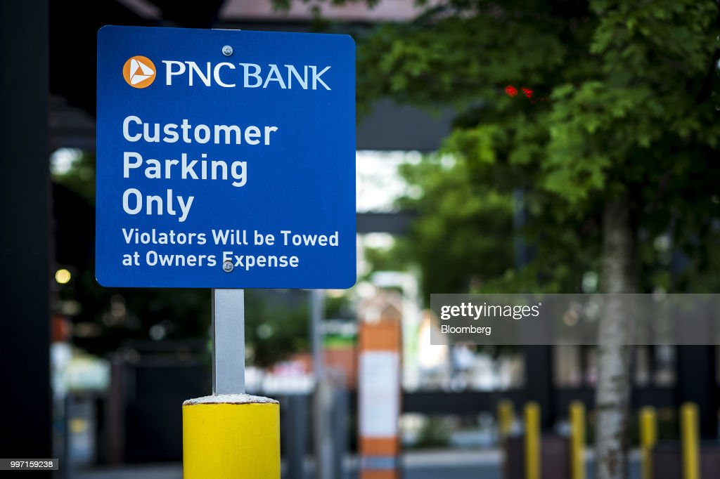 A 'Customer Parking Only' sign stands on display outside a PNC Financial Services Group Inc. bank branch in Chicago, Illinois, U.S., on Thursday, July 12, 2018. PNC Financial Services Group Inc. is scheduled to release earnings figures on July 13. Photographer: Christopher Dilts/Bloomberg via Getty Images
