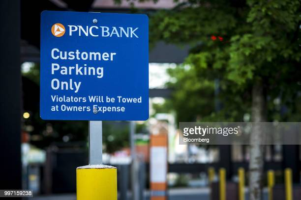 A 'Customer Parking Only' sign stands on display outside a PNC Financial Services Group Inc bank branch in Chicago Illinois US on Thursday July 12...