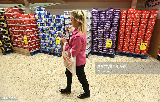 A customer passes a display of Christmas chocolates and alcohol at the Tesco Basildon Pitsea Extra supermarket operated by Tesco Plc in Basildon UK...