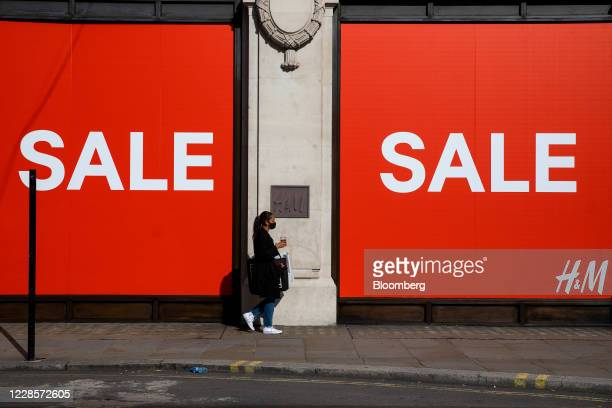 Customer passes a sale sign on Hennes & Mauritz AB fashion retail store on Oxford Street in central London, U.K., on Thursday, Sep. 17, 2020. U.K....