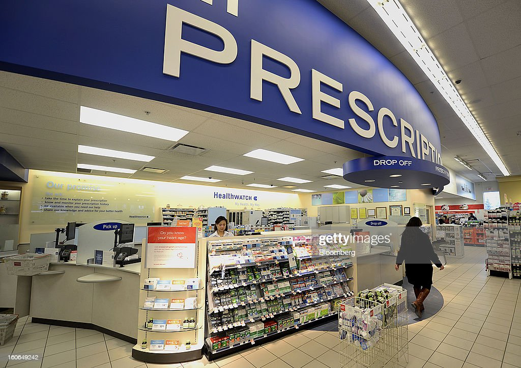 A customer passes by the pharmacy counter at a Shoppers Drug Mart Corp. store in Toronto, Ontario, Canada, on Monday, Feb. 4, 2013. Shoppers Drug Mart Corp., Canada's largest pharmacy chain, is scheduled to release earnings data on Feb. 7. Photographer: Aaron Harris/Bloomberg via Getty Images