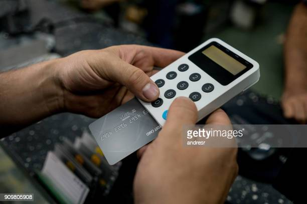 Customer paying by card at a store
