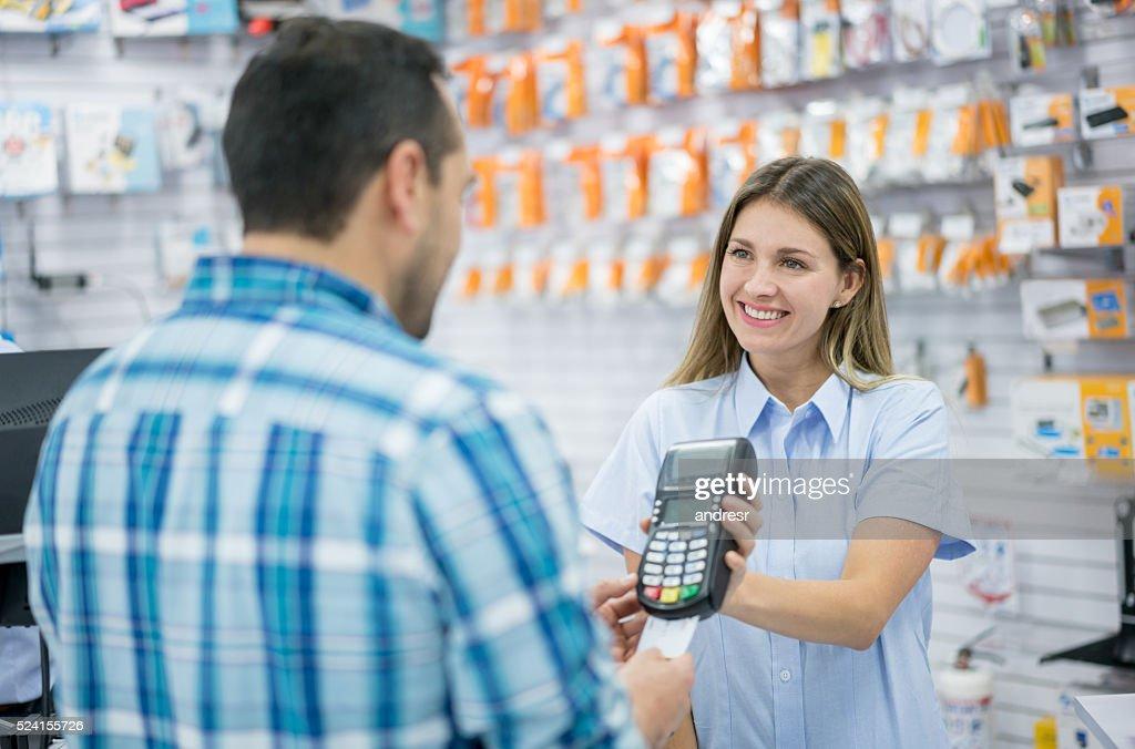 Customer paying by credit card : Stock Photo