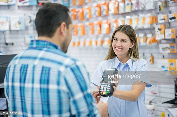 customer paying by credit card - electronics store stock photos and pictures