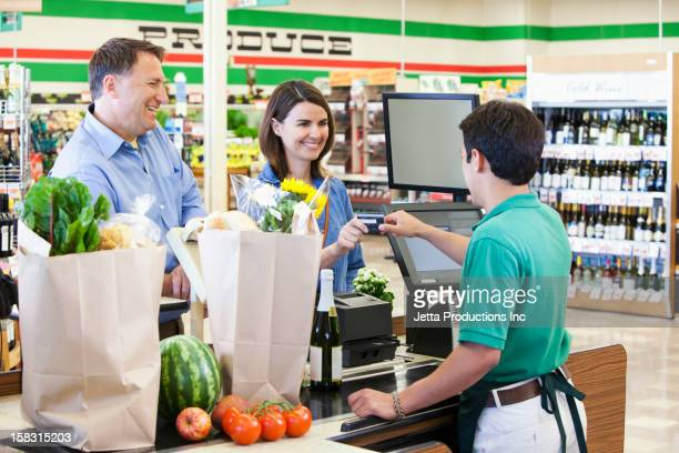 Customer paying cashier in grocer store