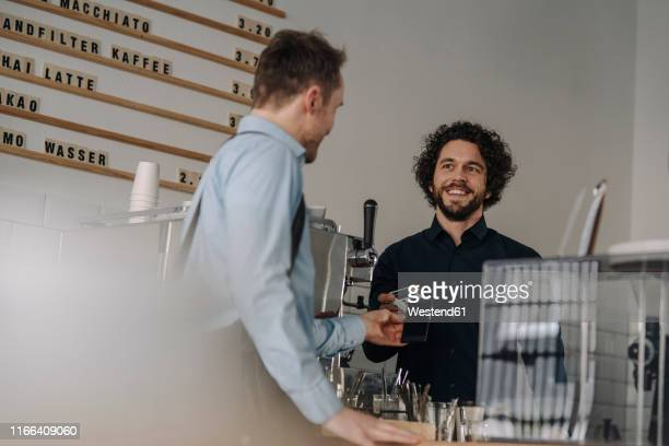 customer paying contactless in a coffee shop - customer focused stock pictures, royalty-free photos & images