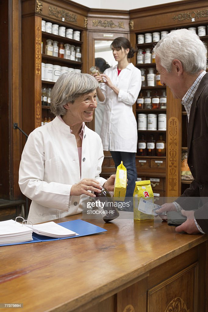 Customer paying drugs in a pharmacy : Photo