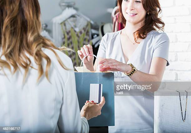 Customer paying in boutique