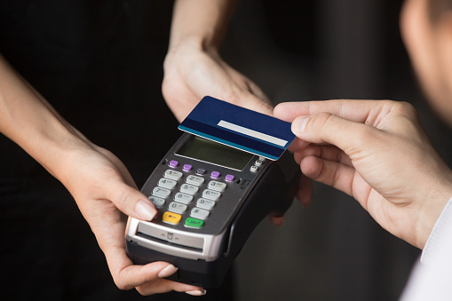 Customer paying in cafe with credit card use NFC technology 1172964151