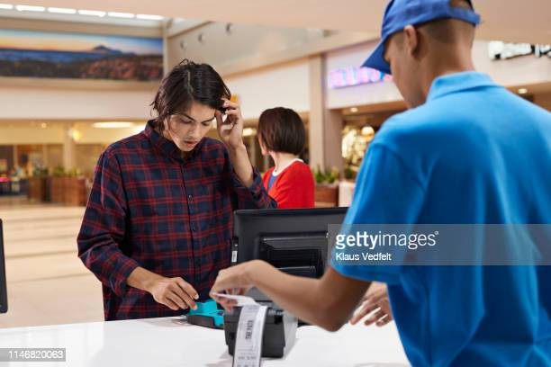 Customer paying through credit card at theater
