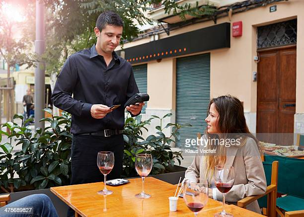 Customer paying with creditcard at restaurant