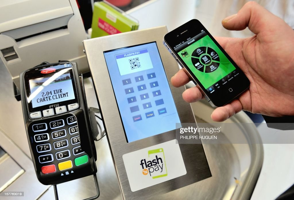 A customer pays at a register with a smartphone application on December 6, 2012 in a Auchan supermarket in Faches-Thumesnil near Lille, northern France