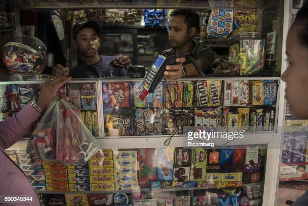 A customer pays for candy with a credit card at a stand in the Chacao district of Caracas Venezuela on Wednesday Dec 6 2017 Venezuelan President...