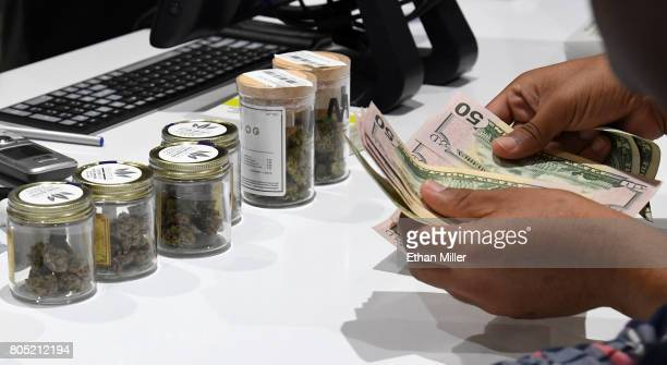 Customer pays for cannabis products at Essence Vegas Cannabis Dispensary after the start of recreational marijuana sales began on July 1, 2017 in Las...