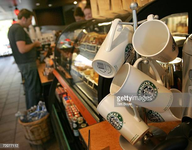 A customer pays for his purchase at a Starbucks store October 3 2006 in Park Ridge Illinois On October 3 2006 Starbucks raised their coffee prices at...