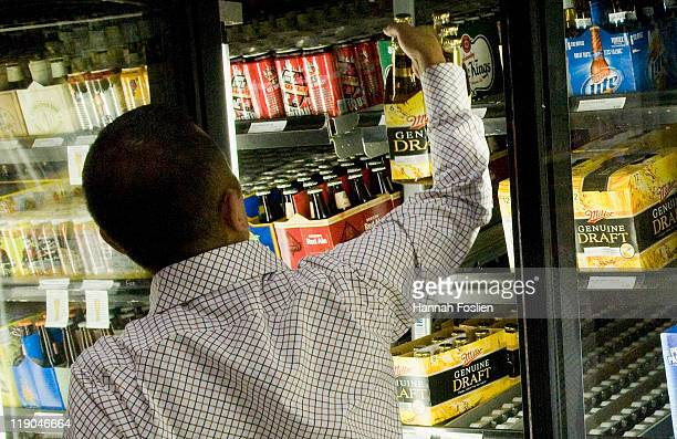 A customer picks out a six pack of Miller Genuine Draft on July 14 2011 at Surdyk's Liquor Store in Minneapolis Minnesota All MillerCoors products...