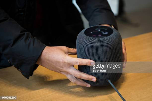 A customer picks up the HomePod speaker on the first day of sales at an Apple Inc store in New York US on Friday Feb 9 2018 Apple Inc's...