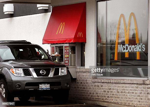 A customer picks up their order at a McDonald's drivethru window January 17 2006 in Rosemont Illinois McDonald's reportedly in an effort to satisfy...