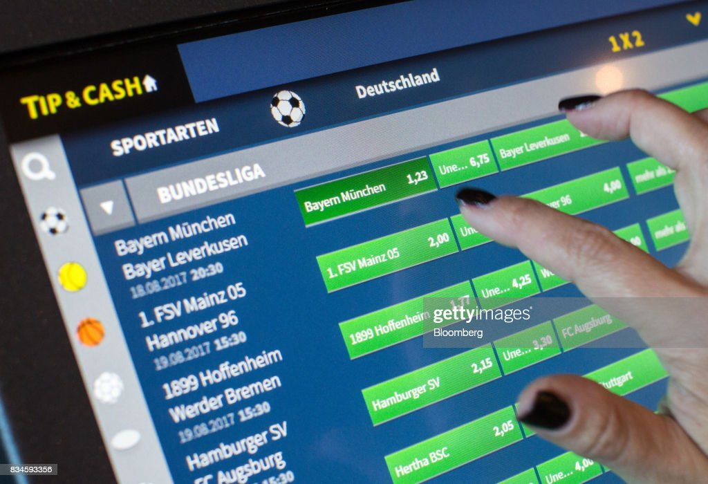 A customer places a bet on a German Bundesliga football match at an electronic betting terminal inside an Admiral Casinos & Entertainment AG casino, operated by Novomatic AG, in Wiener Neudorf, Austria, on Thursday, Aug. 17, 2017. Novomatic is preparing for an initial public offering that could value the Austrian casino and gaming business at about 6 billion euros ($6.3 billion), according to people familiar with the matter. Photographer: Lisi Niesner/Bloomberg via Getty Images