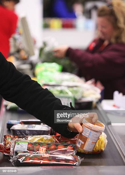 A customer places an item on the checkout belt at a Sainsbury's supermarket in Chafford Hundred UK on Wednesday May 13 2010 The UK's third largest...