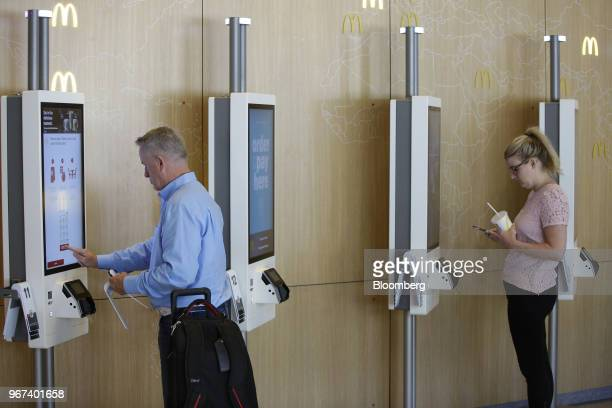 A customer places an order on a kiosk at the restaurant inside the new McDonald's Corp headquarters in Chicago Illinois US on Monday June 4 2018...