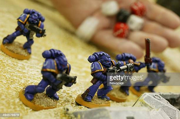 A customer plays a game of Warhammer in a Games Workshop store in London
