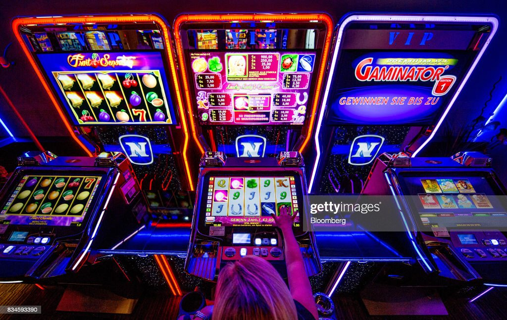 A customer plays on an electronic slot gambling machine inside an Admiral Casinos & Entertainment AG casino, operated by Novomatic AG, in Wiener Neudorf, Austria, on Thursday, Aug. 17, 2017. Novomatic is preparing for an initial public offering that could value the Austrian casino and gaming business at about 6 billion euros ($6.3 billion), according to people familiar with the matter. Photographer: Lisi Niesner/Bloomberg via Getty Images