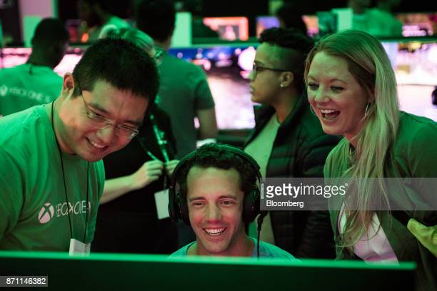 A customer plays on an Xbox Developer Kit version of the Xbox One X game console during the Microsoft Corp global launch event in New York US on...