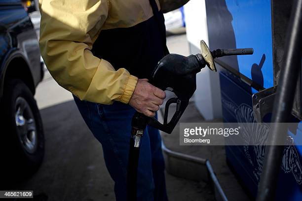 A customer prepares to fill up his gas tank at an Exxon Mobil Corp station in Cincinnati Ohio US on Monday Jan 27 2014 Exxon Mobil Corp is scheduled...