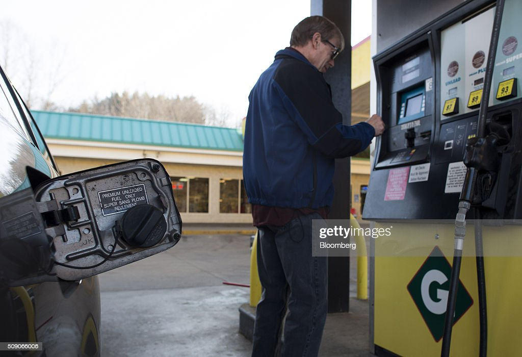 A customer prepares to pump fuel at a Go Mart Inc. gas station in Rockbridge, Ohio, U.S., on Saturday, Feb. 6, 2016. Thanks to a glut of oil that has spurred refiners to make as much fuel as they can, pump prices nationwide are down about 26 cents a gallon from a year ago, which is translating into almost $80 million a day in savings for U.S. drivers, according to Michael Green, a spokesman in Washington for AAA. Photographer: Ty Wright/Bloomberg via Getty Images
